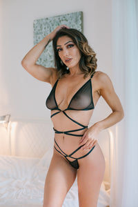 Sheer Strappy Black Bra & Thong set. Soft cup bra with no underwiring that has semi-transparent tulle material on the cups. Shoulder straps which can be adjusted and fastened at the back with a golden fastening. Matching semi-transparent tulle mesh thong is included. Also available in Red and White..