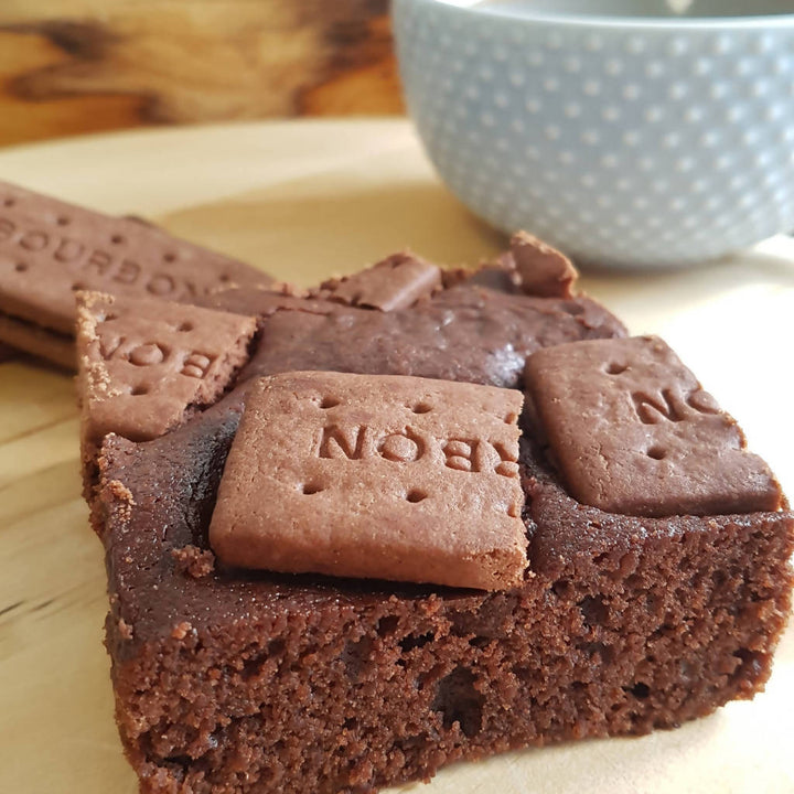 Vegan Chocolate brownie topped with bourbon biscuits