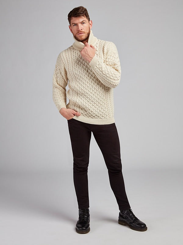 On the picture model is wearing our Aran Knit Polo Neck Sweater in the colour natural