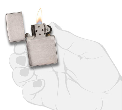 Armor® Brushed Chrome Windproof Lighter lit in hand