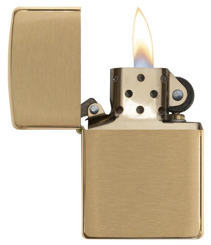 Armor® Brushed Brass Windproof Lighter with its lid open and lit