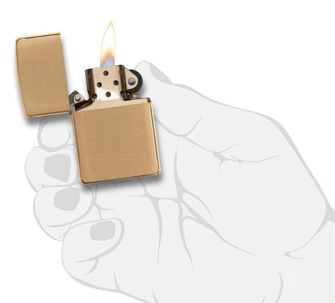 Armor® Brushed Brass Windproof Lighter lit in hand