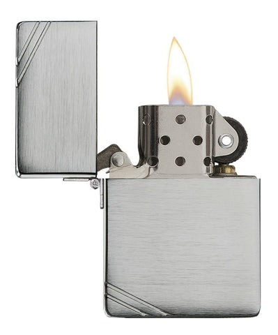 Brushed Chrome 1935 Replica Windproof Lighter with Slashes with its lid open and lit