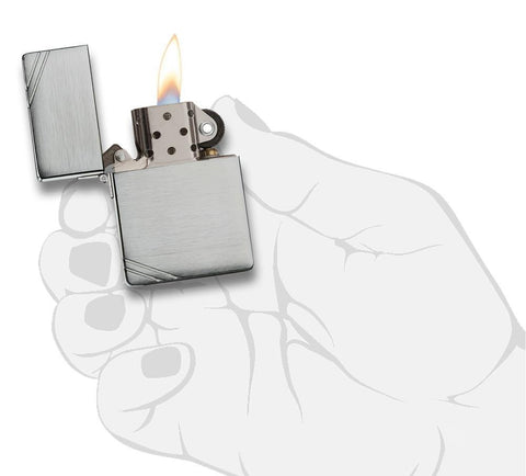 Brushed Chrome 1935 Replica Windproof Lighter with Slashes lit in hand