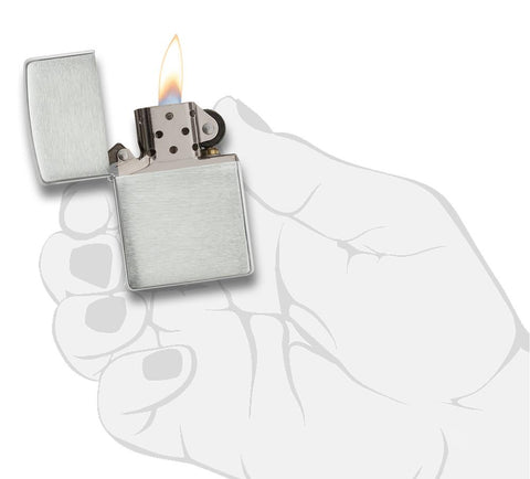 Armor® Brushed Sterling Silver Windproof Lighter lit in hand