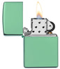 Classic High Polish Green Windproof Lighter with its lid open and lit