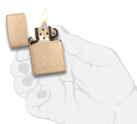 Armor® Tumbled Brass Windproof Lighter lit in hand