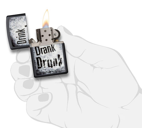 "29618 ""Drink, Drank, Drunk"" Distressed Design on a Black Matte Lighter - In Hand, Open Lit"