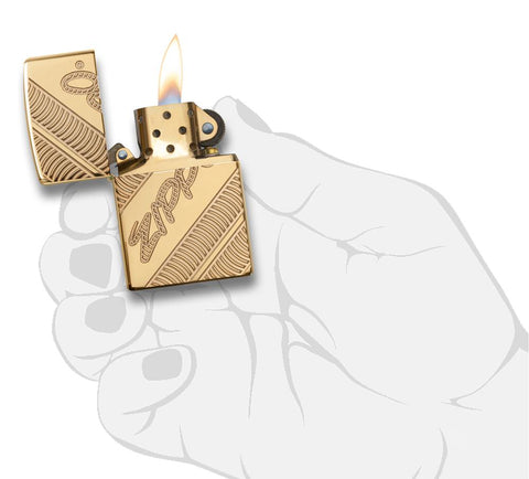 29625 Zippo Coiled Deep Carve Engraving on a High Polish Brass Lighter - In Hand, Open Lit