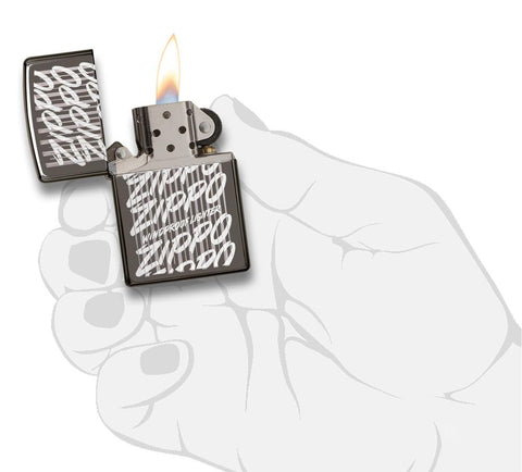 29631 Zippo Script Windproof Engraved Design on a Black Ice Lighter - In Hand, Open Lit