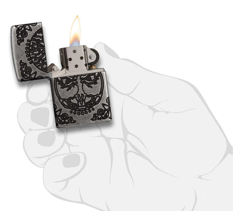 Armor® Tree of Life Windproof Lighter lit in hand