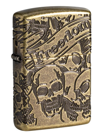 Armor® Antique Brass Skull Design Windproof Lighter standing at a 3/4 angle