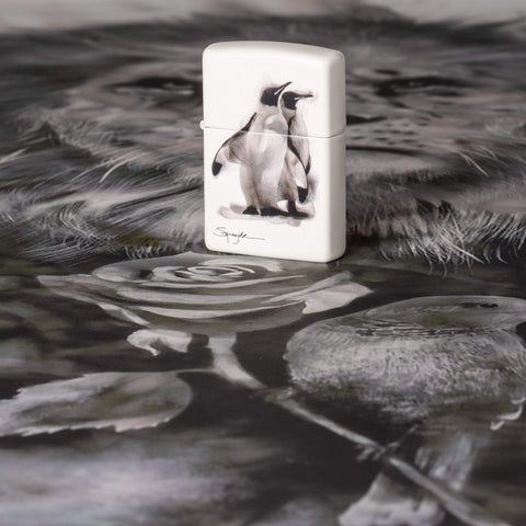 Lifestyle image of Spazuk Penguin Design Windproof Lighter standing on Spazuk artwork