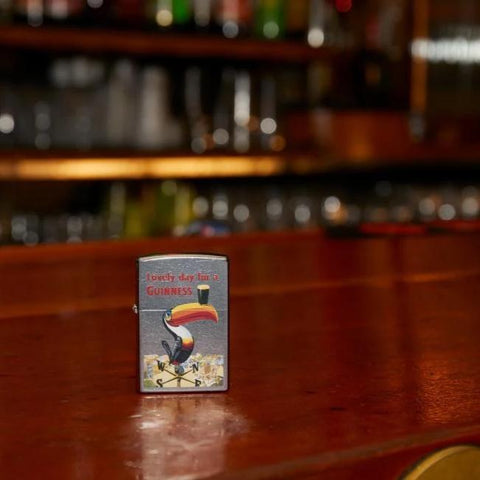 Lifestyle image of Guinness Vintage Toucan Lighter standing on bar