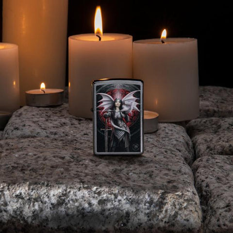 Lifestyle image of Anne Stokes Dragon Warrior Lighter standing on cobblestone with lit candles in the background
