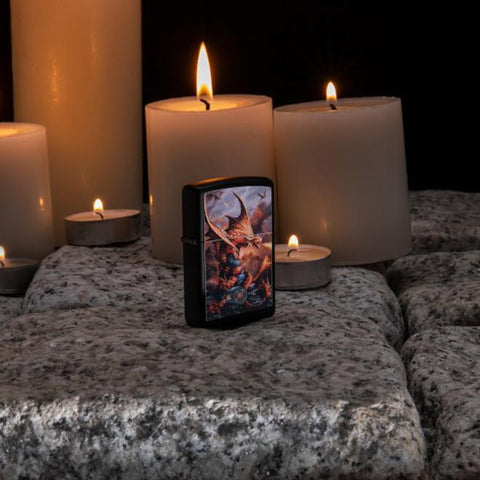 Lifestyle image of Anne Stokes Fire Breathing Dragon Lighter standing on cobblestone with lit candles in the background