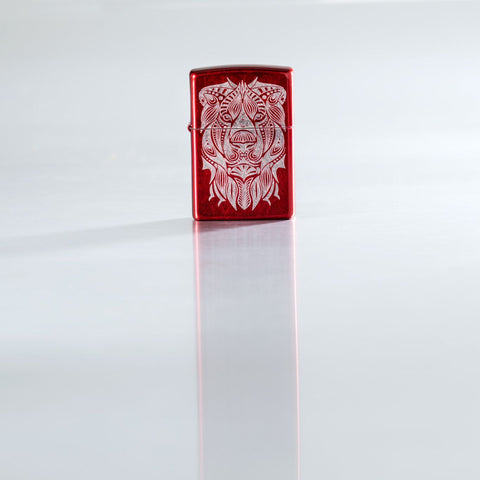 Lifestyle image of Lion Tattoo Design Candy Apple Red Windproof Lighter standing on a reflective surface