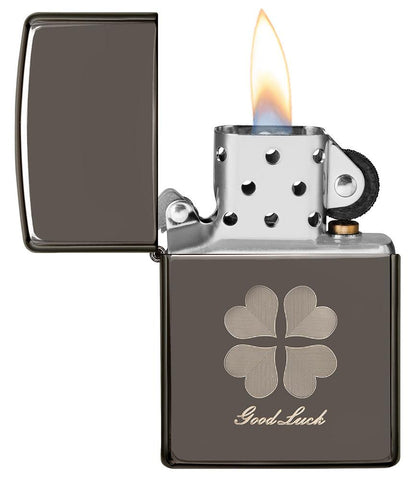 Good Luck Design Black Ice Windproof Lighter with its lid open and lit