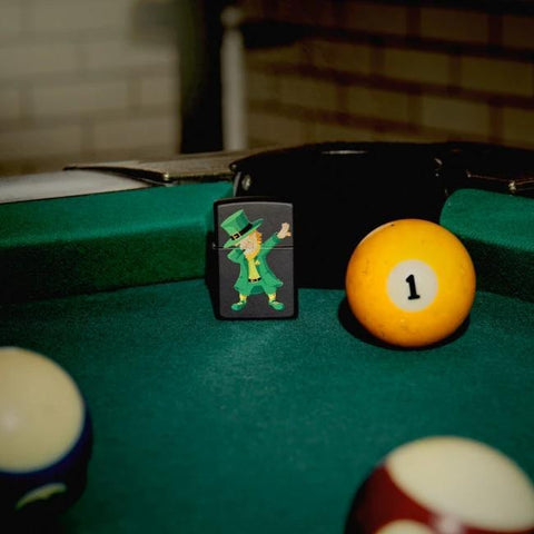 Lifestyle image of Dabbing Leprechaun Design Windproof Lighter standing on a pool table