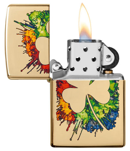 Graffiti Clover Design High Polish Brass Windproof Lighter with its lid open and lit