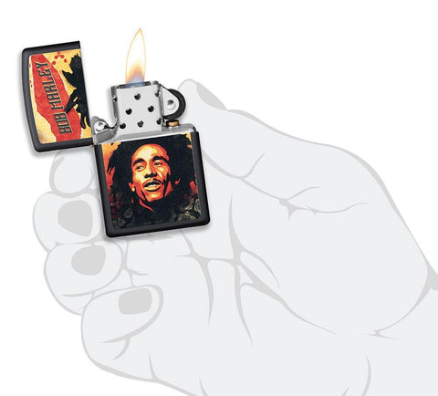 Bob Marley black matte windproof lighter in hand and lit