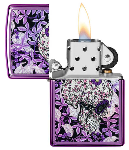 Hidden Skull High Polish Purple windproof lighter with its lid open and lit