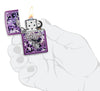 Hidden Skull High Polish Purple windproof lighter lit in hand