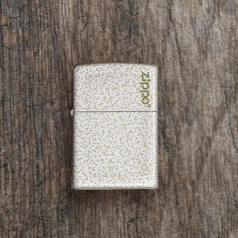 Lifestyle image of Mercury Glass Windproof Lighter laying flat on a wooden surface
