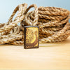 Lifestyle image of Viking Warship Design Brown Windproof Lighter with rope in the background
