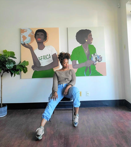 Artist Abi Salami in front of her artwork