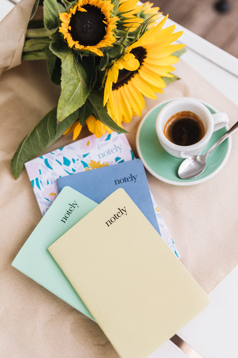 Notely Lemon and Grey Pocket Notebooks with coffee and sunflowers