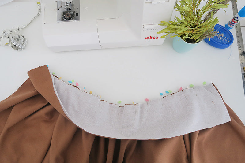 Pin waistband in place