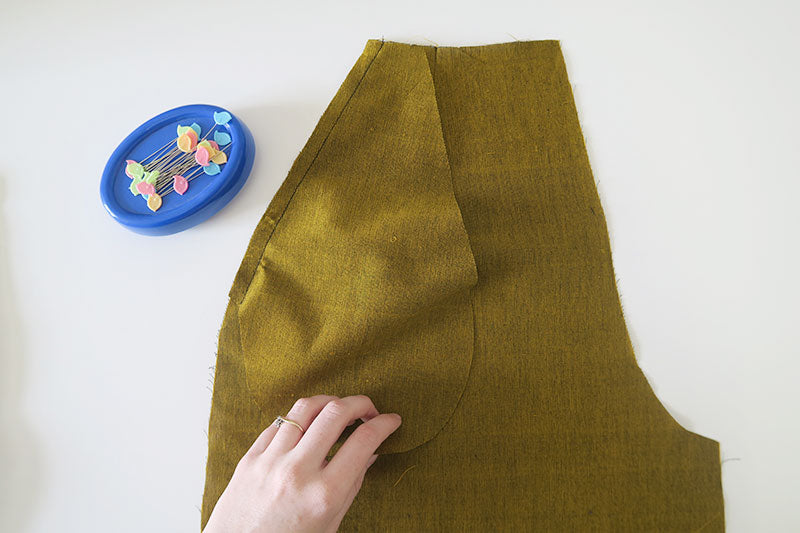 Sew pocket in place