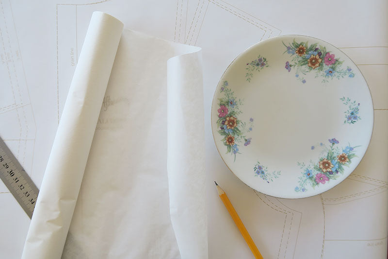 A plate is useful if you don't have a French curve