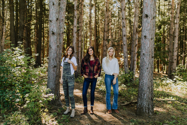 Photos of Three Models Standing in Woods