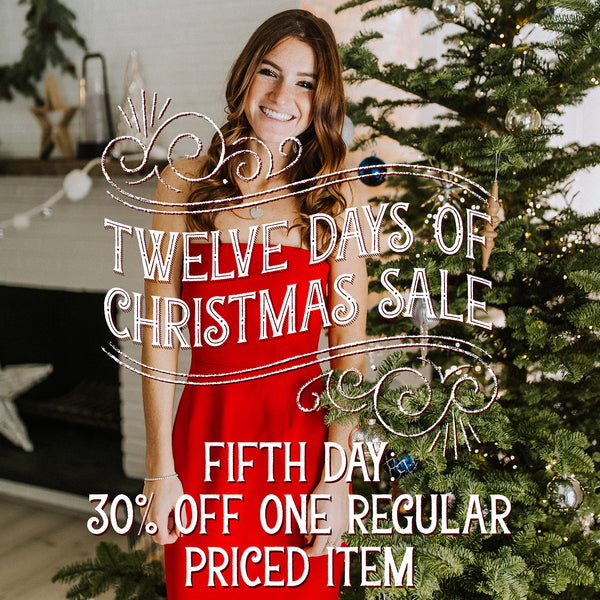 Girl in a Red Dress Standing By a Christmas Tree