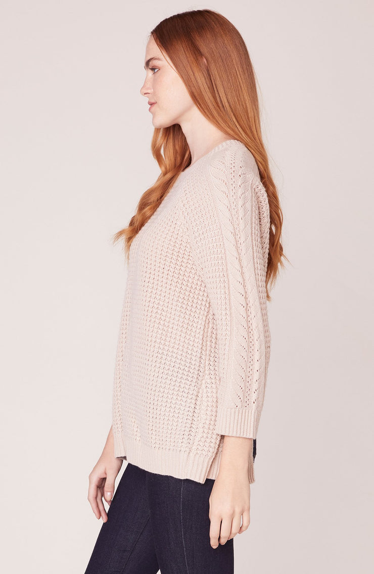 CABLE GIRL SPLIT BACK SWEATER