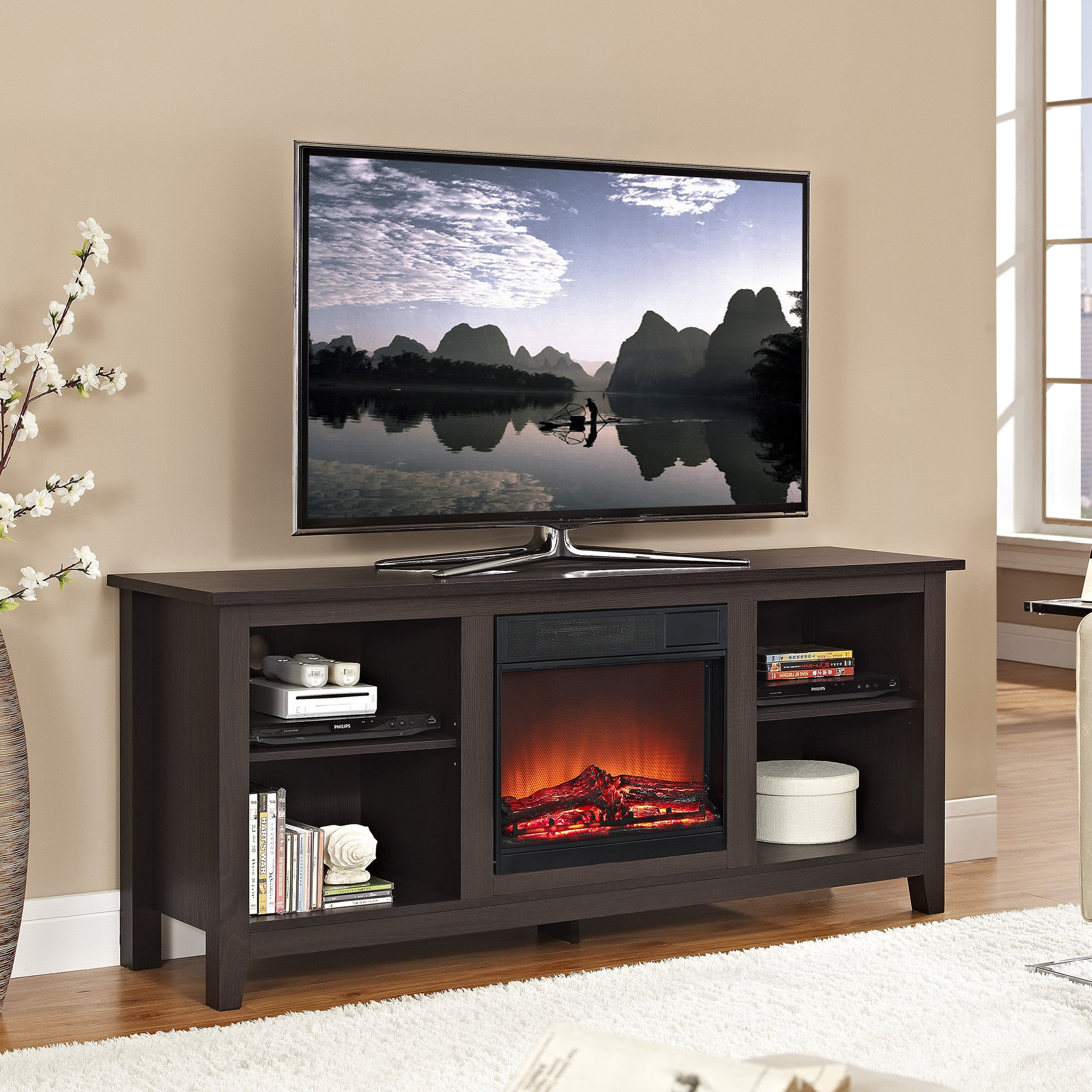 This TV stand is a great idea!  Included in the middle of this stand is an electric fireplace.  No technician