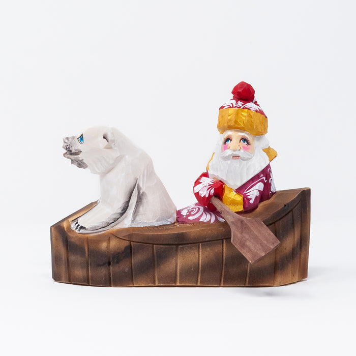 Hand-carved Grandfather Frost with a Polar Bear in a Canoe