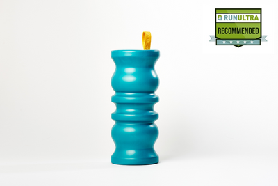 Picture of the manta foam roller in a sea turquoise colour, with a bright yellow finger loop at the top. Run Ultra recommended badge in the top right corner, with 5 stars.