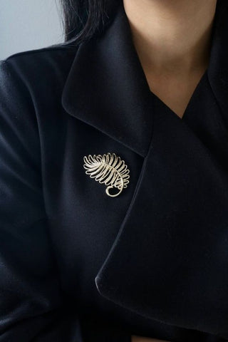 Black coat with a floral leaf gold Vintage brooch. With a Victorian style and is perfect for a Bridal