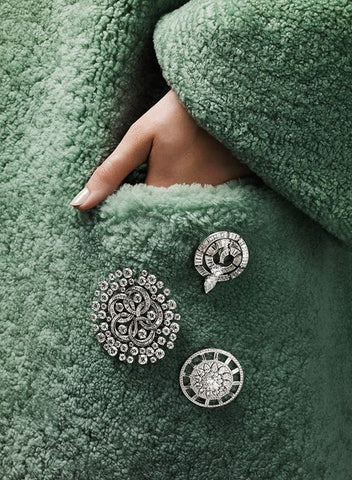 green big coat with three Semi-precious, Silver-plated, and Antiques brooches that add a stunning effect to this green Autumn and winter jacket