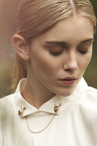 Beautiful young lady with rabbit 1950s inspired brooches on her white shirt. Stunning Gold pin that is Vintage-inspired
