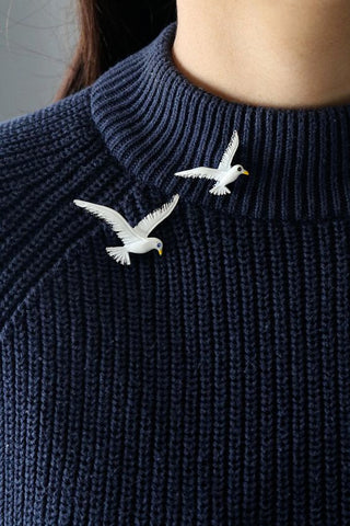 Two beautiful bird brooch on a collar