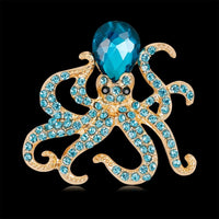Antique octopus brooch vintage in a dazzling blue. Accented with gold plated  that makes it sparkle