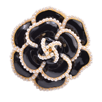 Black retro looking vintage flower brooch