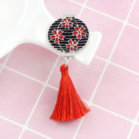 Lantern inspired antique japanese brooch that add flair to any jacket. Stunning red badge with tassel.