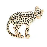 Dazzling and stunning gold leopard brooch pin. It has green gemstones in the eyes and it is exquisite.