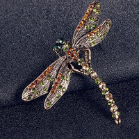 Beautiful vintage dragonfly brooch on a black leather