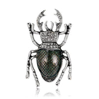 Vintage-inspired black and silver insect brooch with a stunning scarab